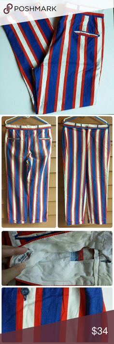 Vintage Clowning Around Pants Tailored in MN Fun, striped red, white and blue trousers with a rolled cuff. Pockets, tab and zip fly. Belt loops and local tailor tag inside with a last name from dry cleaning. A little yellowing on the waist band and a small stain under the back left pocket. Waist is 34 Inseam is 29 A goofy, creative pair of pants Vintage Pants Chinos & Khakis