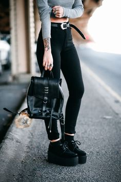 Lua of Le Happy wearing high waisted pants and black leather backpack