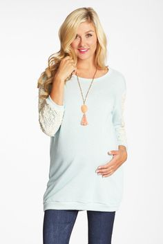 Are you ready for spring? Stand out this dark season in this vibrantly colored knit maternity top.