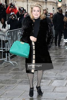 Catherine Deneuve attends the Jean Paul Gaultier show as part of Paris Fashion Week Haute Couture Spring/Summer 2014 on January 22, 2014 in Paris, France.