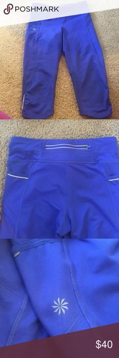 Cute Blue Capris !! Athleta, Like new! Really cute!!!! blue capris (end right below kneecap.) Athleta, like new (worn maybe 2-3 times max). Size small but fit like a medium or even a large! 😶 Very roomy, especially in waist (there is an adjustable waistband hidden inside. The back of the capris are a blue mesh for breathability. Perfect for runners; the capris have reflective detailing on bottom side of legs, upper pockets, and back waistband pocket. Hidden pocket zip on waistband with…