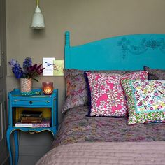 Vintage bedroom with neutral walls, turquoise headboard and turquoise bedside table