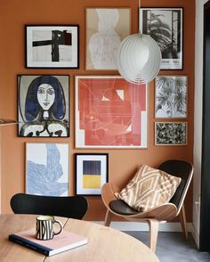 An abstract art gallery wall on a desert orange colored-wall. An abstract art gallery wall on a desert orange colored-wall. Black and White RanunculuGallery wallLarge Wall Art Abstract C Inspiration Wall, Interior Inspiration, 1950s House, Unique Wall Decor, Scandinavian Home, New Wall, Home And Living, Modern Living, Living Room