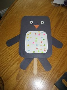 Penguin Puppets - Cut black and a variety of colored construction paper. Use crayons, buttons, etc. to decorate tummy. Assemble the bird. Attach it to a tongue depressor with heavy tape!