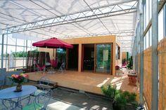 A house built inside of a professional  Greenhouse maison-serre en loire-atlantique