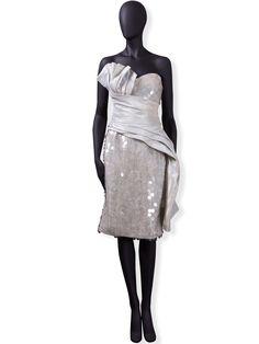 Bagali: Tipo de seda que se dispone a manera de banda. cruza por el echo y se sujeta en la parte baja de las caderas.