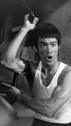 """Jeet Kune Do, or """"The way of the intercepting fist"""" in Cantonese, abbreviated JKD, is a hybrid philosophy of martial arts heavily influenced by the personal philosophy and experiences of martial artist Bruce Lee Bruce Lee Art, Bruce Lee Martial Arts, Bruce Lee Photos, Ben Bruce, Way Of The Dragon, Enter The Dragon, Kung Fu, Bruce Lee Family, Jeet Kune Do"""