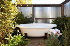 on Gardenista: Drought Gardening Tricks Trending on Gardenista: Drought Gardening Tricks Outdoor bath with corrugated tin walls at Carneros Inn.Trending on Gardenista: Drought Gardening Tricks Outdoor bath with corrugated tin walls at Carneros Inn. Outdoor Bathtub, Outdoor Bathrooms, Outdoor Showers, Front Yard Fence, Fenced In Yard, Low Fence, Small Fence, Lattice Fence, Resorts