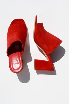 Add a pop of color to your outfit with some red slides