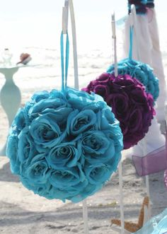 Plum and turquoise pomanders line the aisle