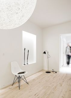 Scandinavian hallway. Features with Moooi Random Light, Herman Miller Eames Molded Plastic Side Chair and Gubi Bestlite BL3S floor lamp. Copenhagen Penthouse I by Norm.Architects.