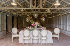 Modern tablescape in a rustic barn