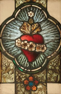 A FINE STAINED GLASS WINDOW of the Immaculate Heart of Mary, 19th century, contained in a sturdy wood frame. Window 30 inches x 19 inches. Frame 32.75 inches x 22.5 inches.