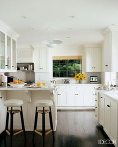 White cabinetry and dark floors.