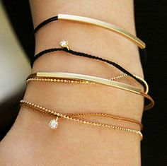 Simple bracelets in black and gold, with little diamond charms