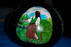 "side one of Sharon's ""Women through history"" painted gourd hanging lamp"