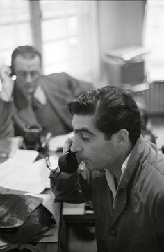 FRANCE. Paris. Robert Capa (foreground) and George Ninaud (office manager) at the Magnum Paris office. 1952. Photo: George Rodger.