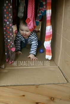 Baby crawl through sensory tunnel.  I love things you can do with a cardboard box.  I had never thought of this.