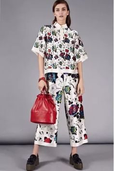 08db41f058ac8 Adorable White   Floral Polo Top Polo top FLOW COLLECTION How To Style  Culottes