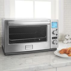 Frigidaire Professional Convection Toaster Oven Item # 610930  Features:  6-slice Capacity, Rapid Cooking Infrared Technology, Bake Pan, Pizza Pan, Reversible Wire Rack, cooks a 12-inch pizza. Costco $129.99