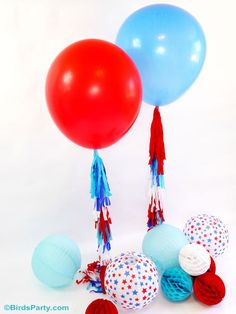 Fun balloon tassels from @birdsparty are the perfect way to add flair to your Fourth of July party