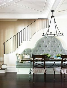 Beautiful banquette... Love the way the curves are mimicked on the stairway wall.