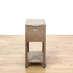 This file box is featured in a polished metal with an antiqued finish. This traditional style storage cart has a lift top with ample storage space, bottom tier, and caster wheels. Perfect for storing tools in the garage! #americantraditional #storage #filecabinet #sandiegovintage #vintagefurniture