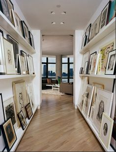 Fabulous idea, super skiny shelves and tons of art. Very cool