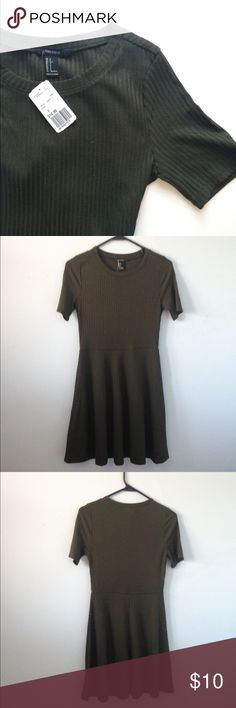 NWT Olive Green Short Sleeve Dress New With Tags F21 Olive Green Short Sleeve Dress with Flare Skirt. Never Worn. 55% Polyester 43% Rayon 2% Spandex. No Trades/ No Modeling/ Price Firm. Forever 21 Dresses
