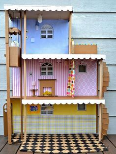 Turn Cardboard Boxes and Paper Towel Rolls into Toys: You could shell out for a cookie-cutter plastic model at the store, or you could let your imagination loose. This fanciful dollhouse, crafted from cardboard and a handful of other miscellaneous materials, would be easy to personalize with your kids' favorite colors, their names or any other details you like. From DIYnetwork.com