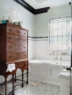 Use a vintage dresser for storage in a bath. A treasure found in Grandma's attic (or on Craigslist) can be an unexpected and elegant addition to the bath. Take this highboy: Deep drawers offer ample linen storage, while delicate legs keep the piece from feeling too heavy and overwhelming the room.