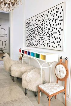 Alexander Liberman\'s dot painting hangs above Garouste & Bonetti\'s console and chairs and a flock of Lalanne sheep in the entrance hall.