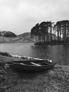 Old rowing boat, moored up on the loch at the holiday cottage. Lochailort, Scotland