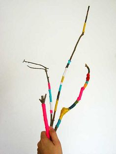yarn-covered sticks! from the blog: Aesthetic Outburst...this is the look I was thinking about for the christmas shaped tree/branch