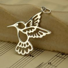 Silver Hummingbird-A personal favorite from my Etsy shop https://www.etsy.com/listing/292056451/large-sterling-silver-hummingbird-charm