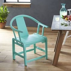 Paola Navone Crate and Barrel Riviera green ming chair - saved by Chic n Cheap Living