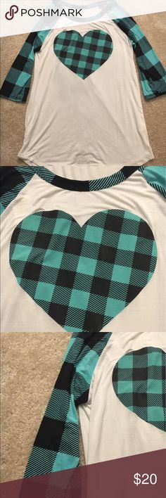 Plaid Heart Tee Green and black plaid sleeves and trim around necklace with heart on front. Never been worn. Soft jersey material. No trades. Reasonable offers accepted Tops