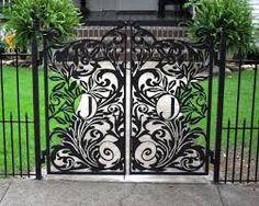Intricate custom metal gate design. Could be cut with a PlasmaCAM machine