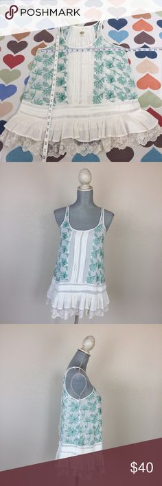 Anthropologie LILKA Sinaloa ruffle embroidered top Lilka from Anthropologie Sinaloa white sleeveless top with green embroidery. ruffle and lace bottom and pleating detail. very light and airy. See through. 100% Rayon. No holes, rips, tears, or pilling noted. Please see pics for condition. Reasonable offers accepted. No 🙅🏻 trades please! Anthropologie Tops