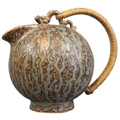 Arne Bang Jug in Stoneware Number 151. c. 1940-1960 | With a braided bamboo Handle and glazed in gray and Brown.