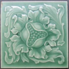 Really nice antique English art nouveau majolica tile from Sherwin & Cotton, c. 1902-1909, depicting a stylized central floral design excellently symmetrical and glazed in fabulous sea-green.