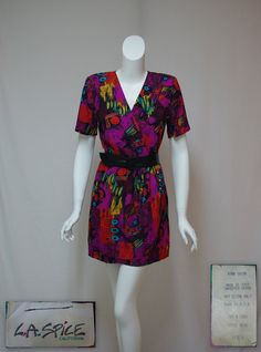 Vintage print dress 1980s rayon skort dress Purple & turquoise print dress Size small dress Professional wear Office wear Casual dress  MEASUREMENTS in inches: stated size is Small  shoulder seam to seam: 15 bust: 35 waist: 27-1/2 hips: 37 sleeve: 9-1/2 v-neck: 9-1/2 zipper: 20-1/2 shoulder to hem: 33 shoulder to waist: 17 waist to hem: 16-1/2 inseam: 6-1/4