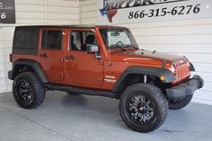 Check out this 2014 Jeep Wrangler Unlimited Sport LIFTED!! in Copperhead Pearlcoat from Hopper Motorplex. It has an Automatic. Engine is ENGINE: 3.6L V6 24V VVT. Call Today!