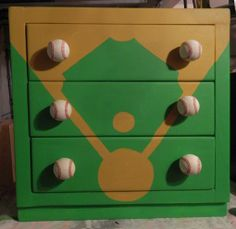 Dresser repainted with a baseball theme (those are real baseballs for handles!)