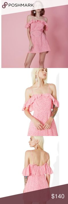 For Love and Lemons Aurora Dress Size L NWT For Love & Lemons Aurora Ruffle Dress can you find the constellations, bb? Turn up yer flirt factor in this versatile mini dress featuring a flowy crepe construction, printed star pattern, fluttery off-shoulder ruffles, spaghetti straps that tie in back, slightly flared hem and zipper closure. Size Large, New with tags. Product Details Large 6/8, bust 38, waist 30, Hips 40 Self: 100% Rayon crepe, Lining: 100% Polyester Dry Clean Only For Love And…