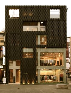 on the corner of insadong road within the retail district of seoul, korea is 'poroscape', a structure dedicated to clothes, designed by korean architect younghan chung.