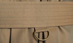 """Waist belt reinforced with 6 rows of stitching to prevent twisting""."