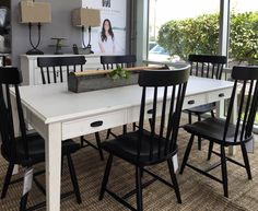 Farmhouse table and spindle chairs by Joanna Gaines for Magnolia Home. At Toms-Price Furniture.