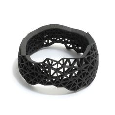 Charles Wyatt - This round 'Shatter Bangle' has been rapid protoyped in nylon and then hand dyed black by jeweller Charles Wyatt -  225 AUD$ at http://www.editionx.com.au
