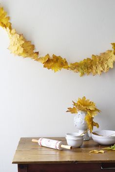 Hurry! Go outside and collect some of those Fall leaves outside your window and make our Fall Leaf Streamer! Cozy!